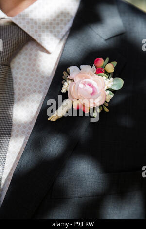 Groom with rose boutonniere on wedding - Stock Photo