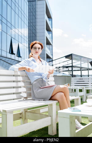 Beautiful fashionable remote worker having relaxing lunch break - Stock Photo
