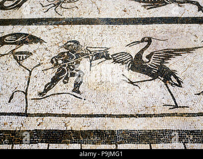 Faun fighting with birds, detail of a mosaic in the city of Italica, founded in 206 BC by Publio … - Stock Photo