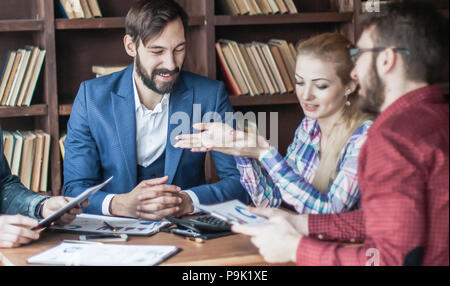 business team discussing a financial report on the company's pro - Stock Photo