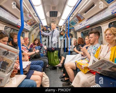 Crowded London Underground carriage, UK - Stock Photo