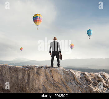 Businessman looks far to the future of the business - Stock Photo