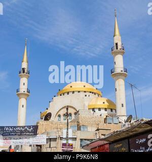 Madaba, JORDAN - APRIL 25, 2016:  Mosque in the centre of Madaba in Jordan - Stock Photo