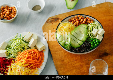 Bowl of buddha with spiralized vegetables on white wooden table. Healthy food clean eating - Stock Photo