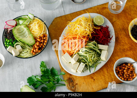 Bowl of buddha with spiralized vegetables on white wooden table, top view. Healthy food clean eating - Stock Photo