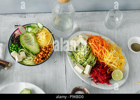 Healthy food clean eating. Spiralized vegetables with bowl of buddha on white wooden table top view - Stock Photo