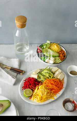 Healthy food clean eating. Spiralized vegetables with bowl of buddha on white wooden table - Stock Photo