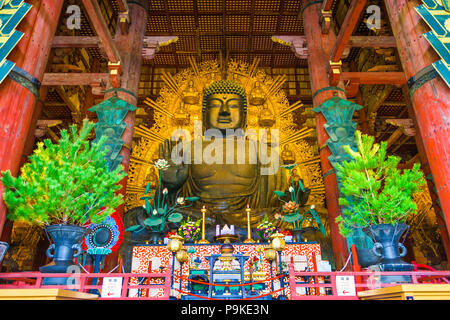 NARA, JAPAN - NOVEMBER 19, 2015: The Todaiji Buddha. It is considered the world's largest bronze statue of the Buddha Vairocana. - Stock Photo