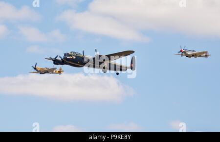 BBMF - Avro Lancaster & two Supermarine Spitfires performing a flypast celebrating the centenary of the Royal Air Force at the 2018 Air Tattoo - Stock Photo