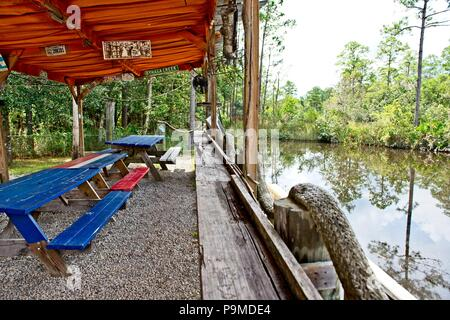 View of a a picnic area that sits on a dock along Old Fort Bayou in Ocean Springs, MS - Stock Photo
