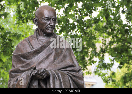 The bronze statue of Mahatma Gandhi in Parliament Square, Westminster, London, is a work by the sculptor Philip Jackson. - Stock Photo