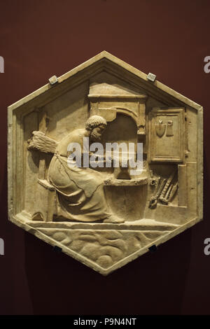 Tubalcain as personification of the beginning of metal work depicted in the hexagonal relief by Italian Renaissance sculptor Andrea Pisano (1334-1343) from the Giotto's Campanile (Campanile di Giotto), now on display in the Museo dell'Opera del Duomo (Museum of the Works of the Florence Cathedral) in Florence, Tuscany, Italy. - Stock Photo