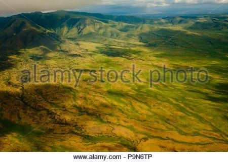 Aerial of mountains and farmland near Lake Manyara, Tanzania. - Stock Photo