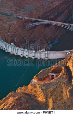 The high and dry spillway, right, on the Glen Canyon Dam. - Stock Photo