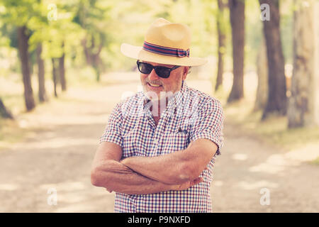 Expressive face expressions on good looking senior man casual summer dressed happy, funny and characteristic in life is too short live the most you ca - Stock Photo