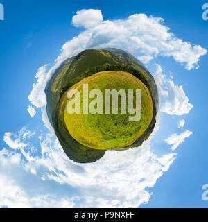 spherical panorama of little mountain planet. lovely countryside concept with 360 degree view. agricultural field on hillside and village in the valle - Stock Photo