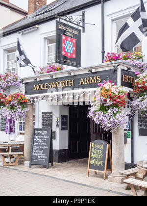 The Molesworth Arms pub and hotel in Wadebridge Cornwall UK with pretty window boxes and hanging baskets full of flowers in summer - Stock Photo