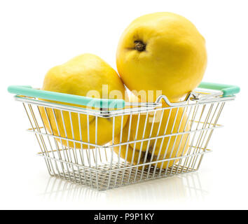 Three yellow quince in shopping basket isolated on white background raw fresh - Stock Photo