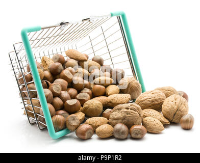 Nuts mix (walnut, hazelnut and almond) out a shopping basket isolated on white background - Stock Photo