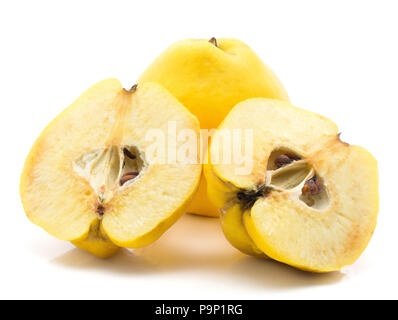 Two yellow quinces one cut in half isolated on white background raw ripe two halves - Stock Photo