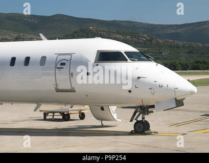 Commercial passenger plane in the airport. Aircraft maintenance. - Stock Photo
