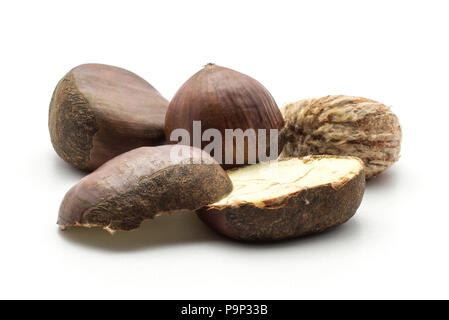 European chestnuts Spanish edible one peel and sliced isolated on white background raw fresh brown nuts two halves - Stock Photo