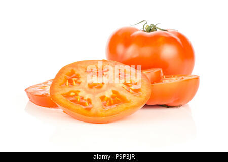 One red tomato and fresh cut circle slices isolated on white background - Stock Photo