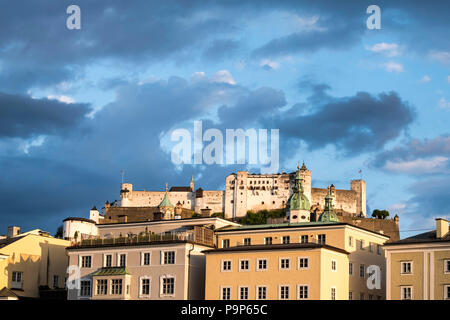 Salzburg cityscape with Fortress Hohensalzburg at dusk - Stock Photo