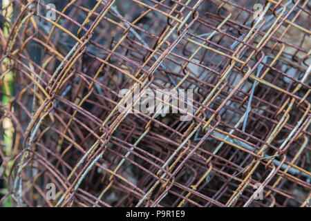 Iron mesh for fence with rust and paint. - Stock Photo