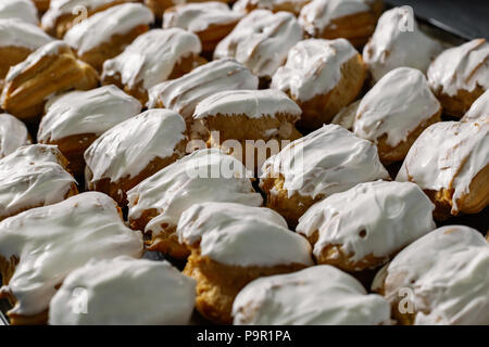 Cakes on a spacing in large quantities. - Stock Photo