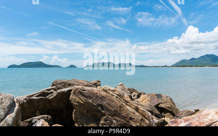 Scenery or landscape of the beach at Prachuap Khiri Khan Thailand. Sea or brine and rock or stone and blue sky and green tree mountain.  Summer concep - Stock Photo