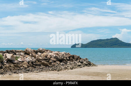 Rock or stone mound or pile on the beach at Prachuap Khiri Khan Thailand. Beach and sea or brine and blue sky and green tree mountain or hill.  Summer - Stock Photo