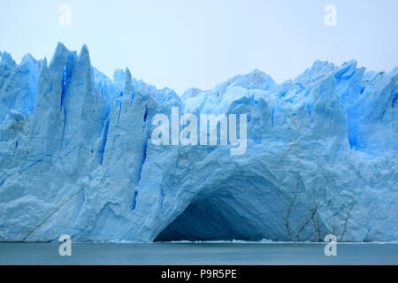 Incredible view of the ice blue Perito Moreno Glacier's huge front wall as seen from cruise boat on Lake Argentino, El Calafate, Patagonia, Argentina - Stock Photo