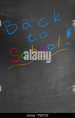 Back to school colorful chalk text on blackboard or chalkboard as primary elementary education class teacher welcome concept - Stock Photo