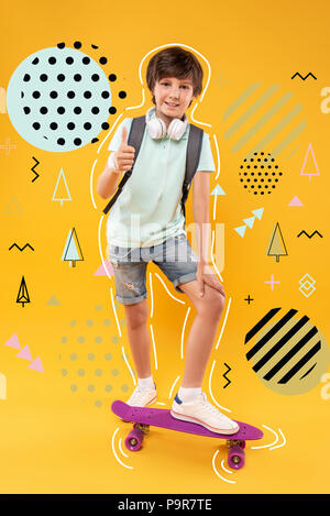 Positive child having a skateboard and enjoying his active childhood - Stock Photo