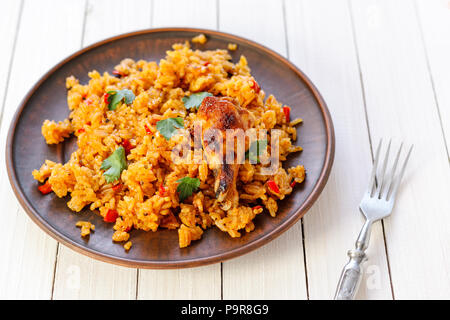 fried rice with chicken on a wooden table. Traditional cuisine - Stock Photo