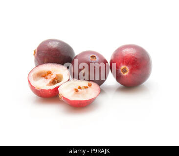 Sliced cranberry close-up isolated on white background three whole and one cut in half - Stock Photo