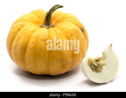 One whole yellow pumpkin and white slice isolated on white background - Stock Photo