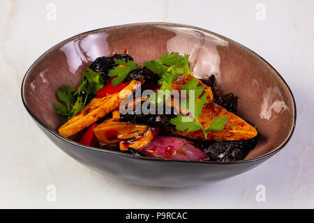 Fried tofu with mushrooms and coriander - Stock Photo