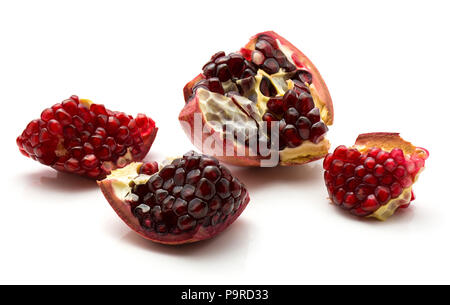 Four pomegranate pieces with grains isolated on white background - Stock Photo