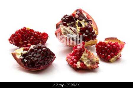 Five pomegranate pieces with grains isolated on white background - Stock Photo