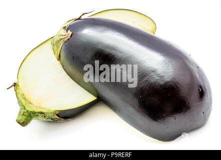 Two halves eggplant (aubergine), longitudinal section, isolated on white background - Stock Photo