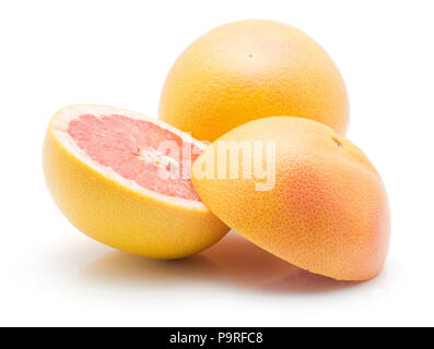Sliced red grapefruit and one whole isolated on white background - Stock Photo