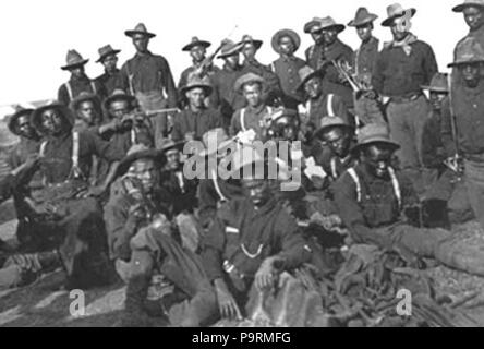 . Buffalo Soldiers of the 10th Cavalry Regiment circa 1898, Augustus Walley (top row, 2nd from right, with the bandana around his neck), a former slave from Bond Avenue in Reisterstown, MD, earned the Medal of Honor. circa 1898 256 BuffaloSoldiersAW - Stock Photo