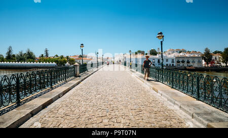 Ancient Roman historical bridge in Tavira, Algarve. Portugal - Stock Photo