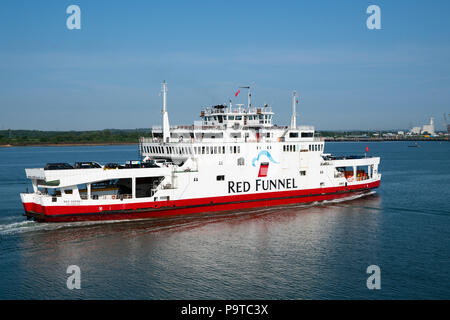 Red Funnel's Red Osprey sails from East Cowes to Southampton Docks on a sunny summer day. - Stock Photo