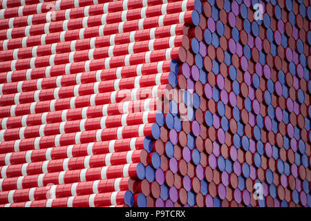 Bulgarian artist Christo unveils his first UK outdoor work, The Mastaba, a 20m high installation on Serpentine Lake made of 7,506 barrels. The Mastaba is 30 metres wide and 40 metres long. The barrels visible on the top and the two slanted walls are painted red and white; while the ends of the barrels visible on the two vertical walls are painted red, blue and purple.  Featuring: Atmosphere, View Where: London, England, United Kingdom When: 18 Jun 2018 Credit: Wheatley/WENN - Stock Photo