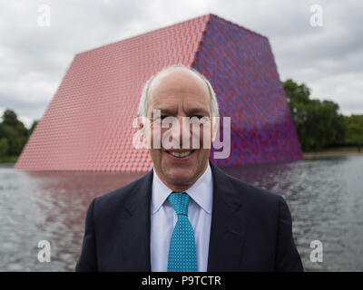 Bulgarian artist Christo unveils his first UK outdoor work, The Mastaba, a 20m high installation on Serpentine Lake made of 7,506 barrels. The Mastaba is 30 metres wide and 40 metres long. The barrels visible on the top and the two slanted walls are painted red and white; while the ends of the barrels visible on the two vertical walls are painted red, blue and purple.  Featuring: Loyd Grossman Where: London, England, United Kingdom When: 18 Jun 2018 Credit: Wheatley/WENN - Stock Photo