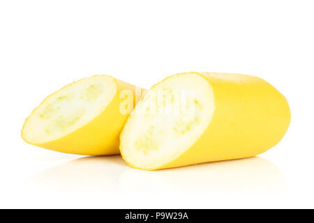 Group of two halves of raw yellow zucchini one cut in halves isolated on white - Stock Photo