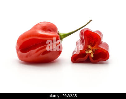 Red Habanero chili with one half isolated on white background hot Chinese pepper - Stock Photo